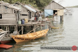 """The school boat outside the homes of """"anak laut"""", the sea tribe children."""