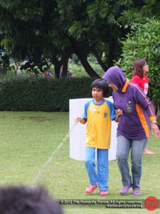 Race Relay game. The rope is to assist the kid in getting a direction.