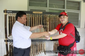 Official handover of angklung set, tradtional musical instrument made of bamboo.