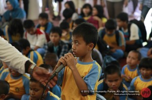 A boy asks where the volunteers come from. We're from Singapore and Indonesia.