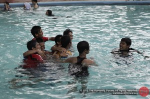The high school boys have a great time in the freezing cold pool.